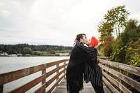 Nonbinary Transgender Couple Giving Kiss on Bridge